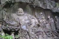 Engraving of laughing Buddha