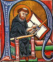 Medieval monk writing on a book tablet