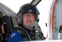 "Photo shop version of author of ""Arash's World"" as airplane pilot"