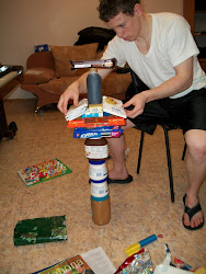 Chris' companion playing Jenga with the Christmas Box Goodies