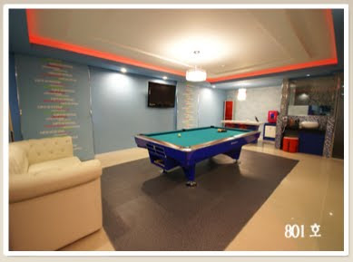 The VIP room, one of four classes, has a pool table.