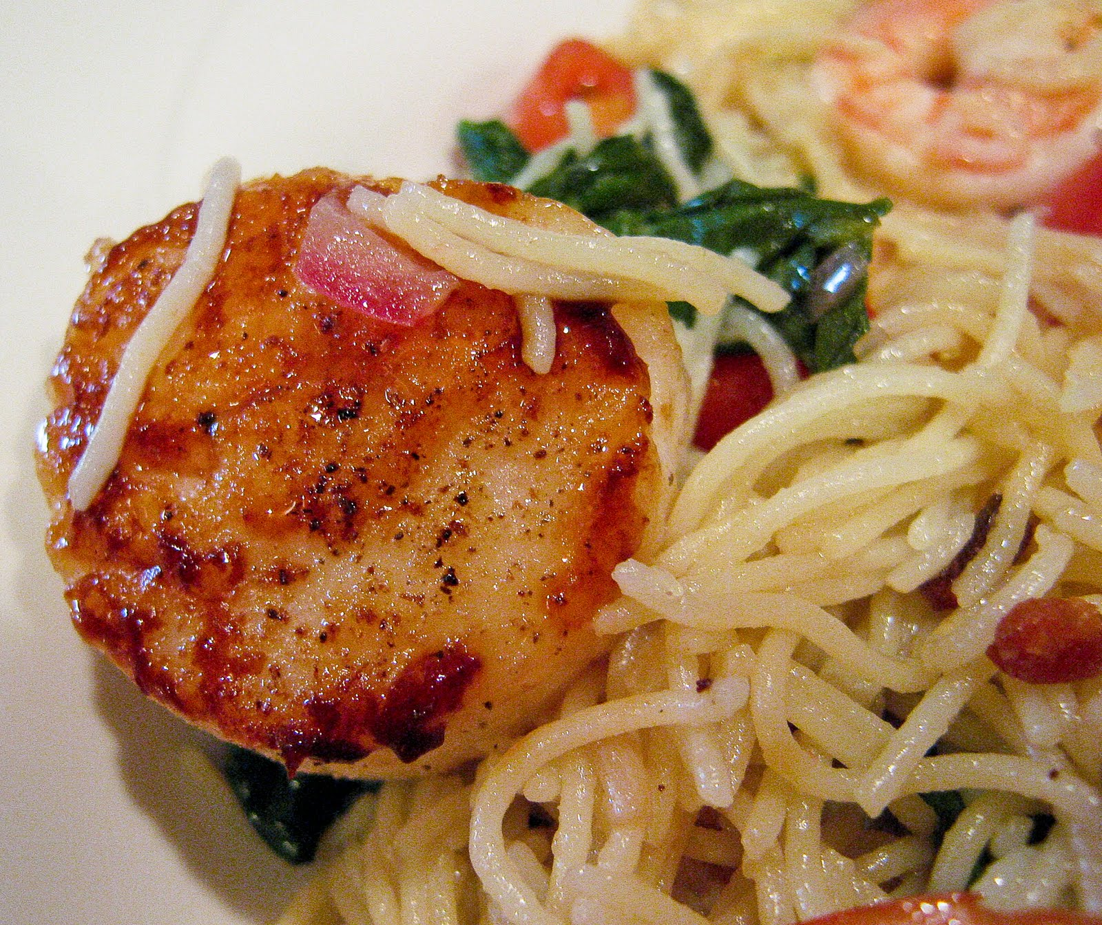 Shrimp Scallops Tossed With Capellini Spinach Tomatoes Bacon