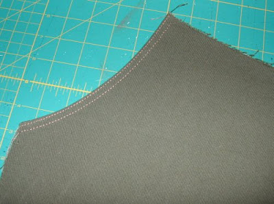 The next step was to serge/overlock the pocket facing and bag together ...