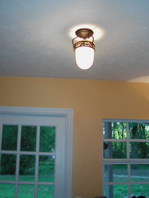 And the wall sconce (why does anyone need a wall sconce in a laundry