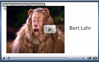 Bert Lahr as the Cowardly Lion from a Screen Movie about with images, music, and caption text.