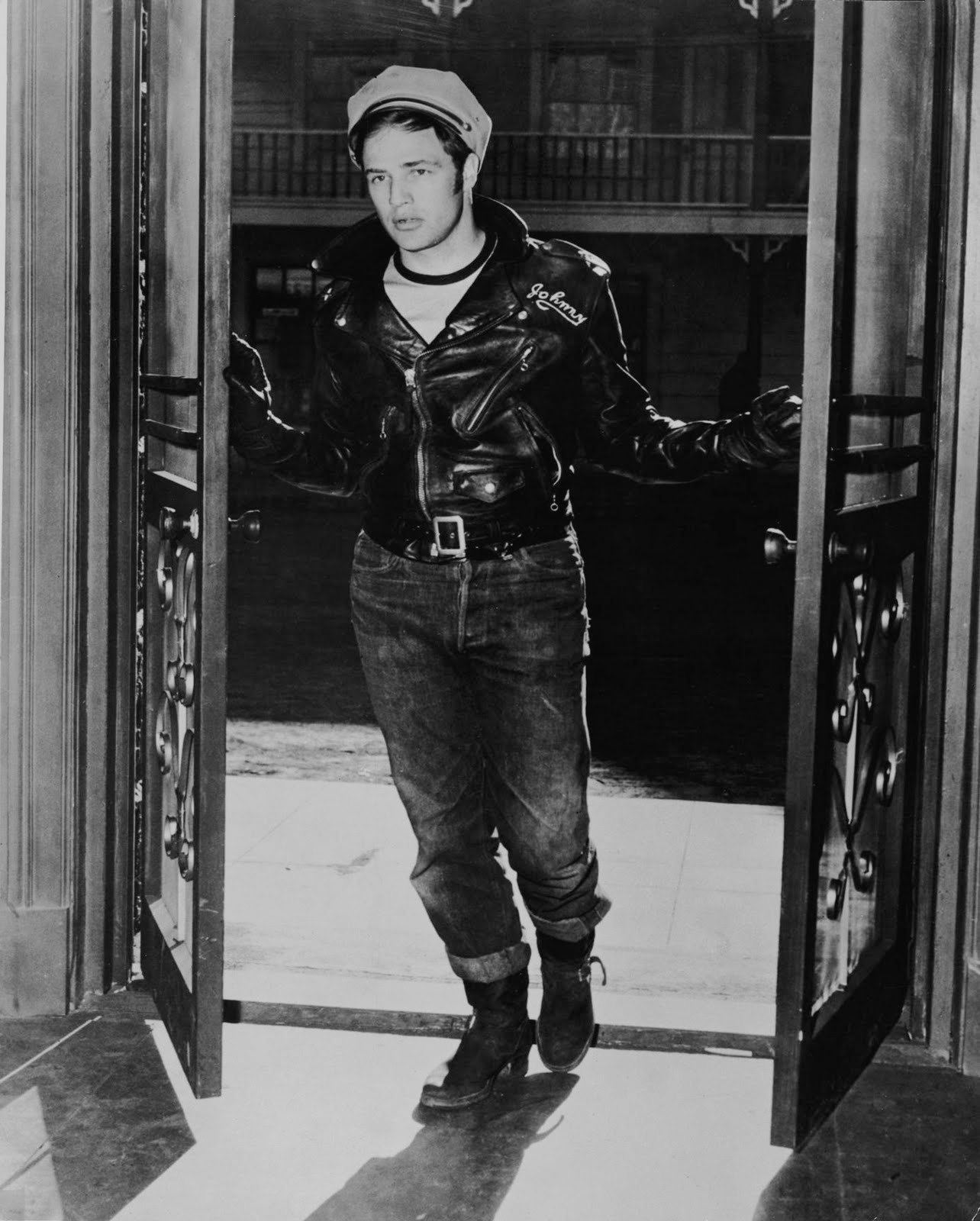 When you think of biker leather jackets and men in leather jackets in the movies one of the first films that probably springs to mind is the classic film, The Wild One, starring a young, ruggedly handsome Marlon Brando.