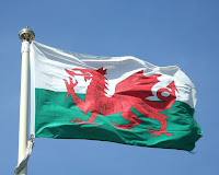 Flag of Wales, Y Ddraig Goch, by Calum Hutchinson via Wikimedia Commons - released by author into public domain