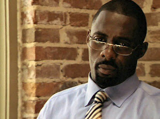 Real name: Idris Elba. Forever to be known as: Stringer Bell.