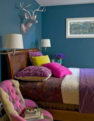the deep purple walls and dark wood make this room very romatic and