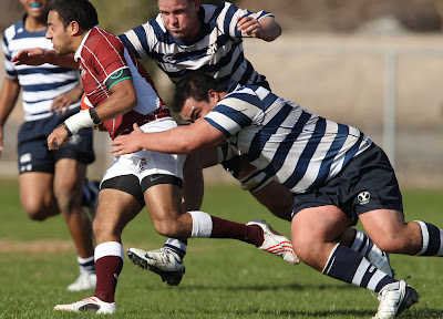 BYU Rugby Big Boys, Prop Ray Forrester and Lock Mark Bonham, swarm an overly optimistic Texas A&M player