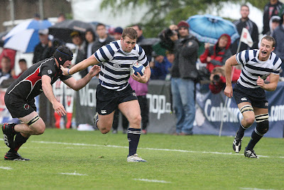 Hooker Joey Mount stiff arms an SDSU forward while Flanker Nate Maughan follows in support