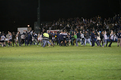 BYU Rugby players and fans rush the field to immediately celebrate the miracle victory