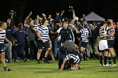 BYU Rugby players and fans swarm together, celebrate the win
