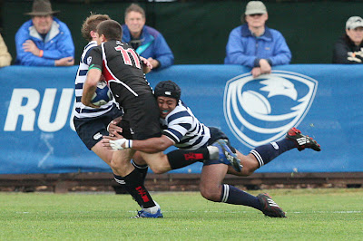 BYU Rugby Flanker Apenisa Malani wraps up a SDSU player