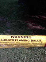 It says, 'WARNING: SHOOTS FLAMING BALLS'