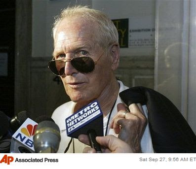 In this Aug. 3, 2005 file photo, actor Paul Newman speaks with members of the news media in Philadelphia, after meeting with city officials to discuss to possibility of bringing a Champ Car series race to the city. Newman, the Academy-Award winning superstar who personified blue-eyed cool as an activist, race car driver, entrepreneur and the anti-hero of such films as 'Hud,' 'Cool Hand Luke' and 'The Color of Money,' has died. He was 83