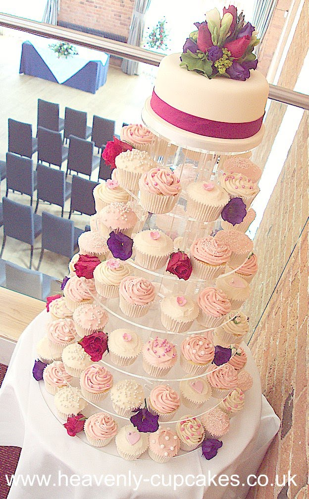 pink and white wedding cupcakes. The pink and white wedding cupcakes were all decorated with assorted