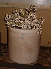 Old three gallon crock with tallow berries