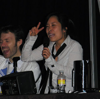 Stephanie Sheh (right, voice of Mikuru) and Mike Sinterniklaas (left) get the audience amped up about Bandai's upcoming release of The Disappearance of Haruhi Suzumiya.