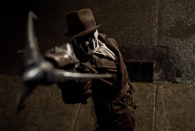 Rorschach fires a grappling hook gun