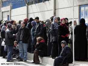 Iraqi refugees wait to register outside a U.N. office in Duma, Syria, on Feb. 14th.
