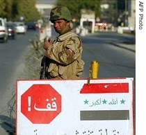 An Iraqi soldier controls traffic at a checkpoint in central Baghdad.