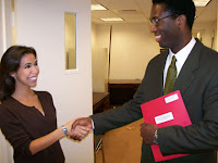 Emily Stivers delivers a packet of letters and bill information to Legislative Counsel Greg Chaney in Sen. Stabenow's office.
