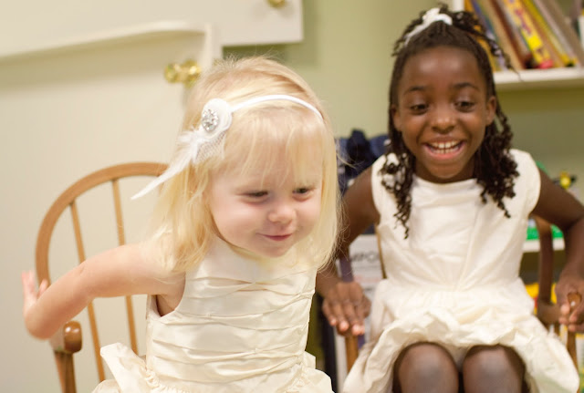 Flower girls playing before the wedding by Atlanta wedding photographer