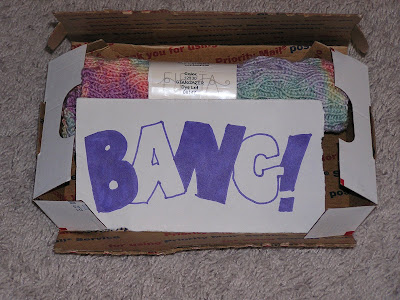 an open box showing knitting and a hand-lettered