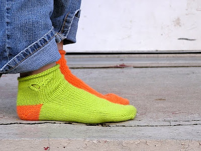 view of the green sock, with the butterfly ankle showing