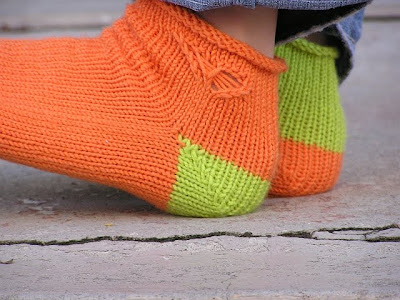 close up on the orange ankle, showing the butterfly and the roll top