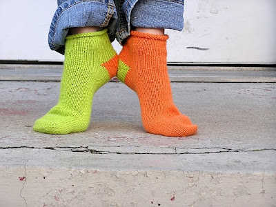 green and orange socks, model standing on her toes