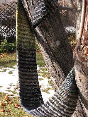 striped scarf hanging in a tree