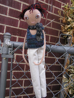 boy doll wearing vest scarf and khaki pants