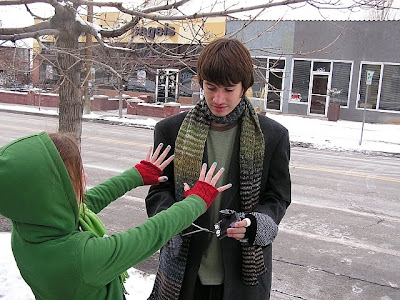 teen ooking at hands in fingerless gloves