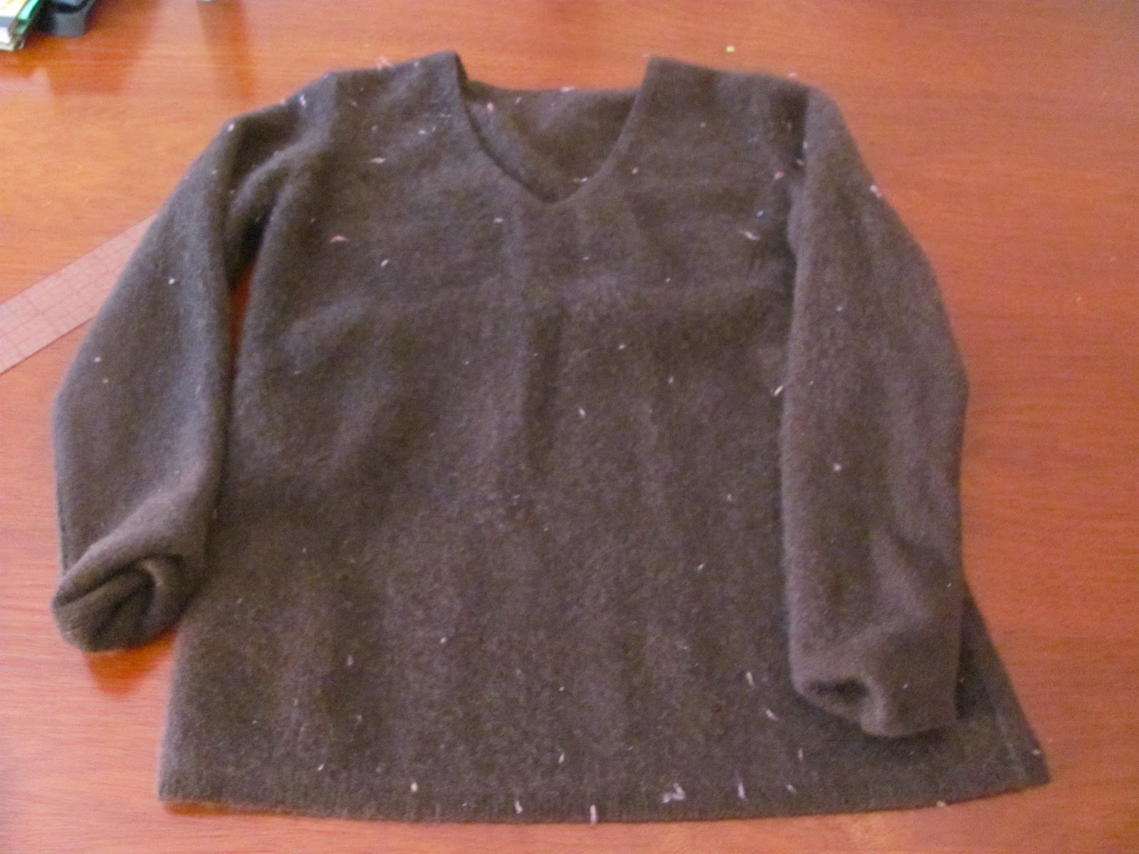 5876104b99a0 How to make a baby sweater from an adult sweater
