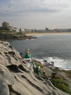 A makeshift home on a rocky ledge