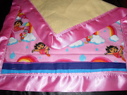 Themed Blankets and Toss Pillows with Matching Doll sized Blanket and Pillow .