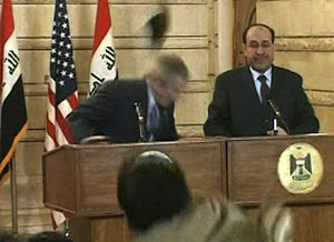 Reporter throws shoe at Bush during news conference in Iraq