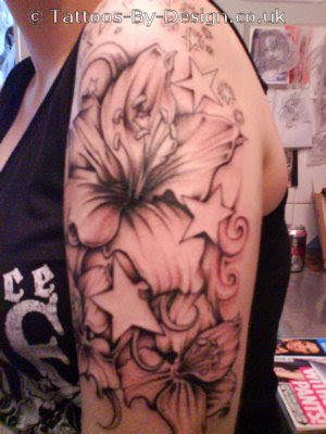 lauras flower at arm. Angel tattoo at side body