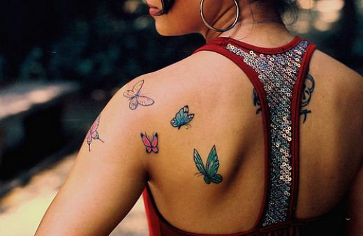 butterfly and star tattoos. tribal tattoos, utterfly
