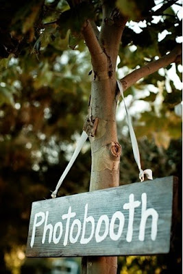 A wooden sign? Hanging from a tree? Whats not to like?