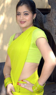 hot+indian+aunty+hot+scenes+exclusive+in+yellow+saree.jpg