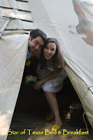 couple peeking out of tipi