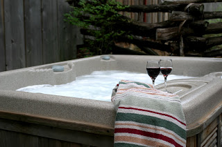 hot tub with wine glasses on the side