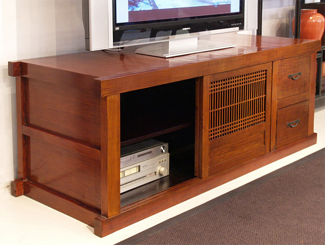a wooden TV stand is still