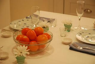 table setting with clementines and flowers