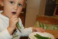 eating green beans in kitchen