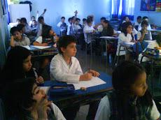 Cuarto Básico C, participando de la clase de Lenguaje.