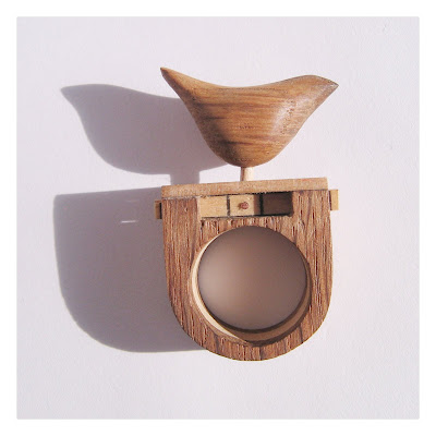 Kinetic wooden bird ring.